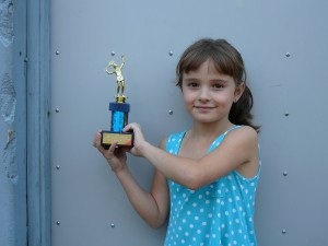 Sasha, aged 6, feeling proud after acing a tennis trophy