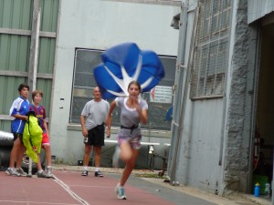 Maddy having fun working on her sprinting with the resistance of a parachute
